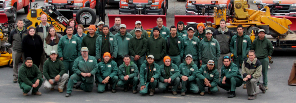 team of landscape professionals with trucks and equipment leesburg