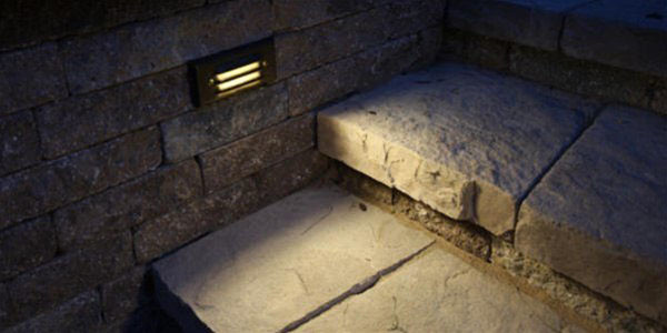stone pathway with lights on at night