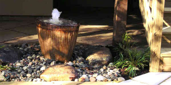 stone water fountain feature in a yard