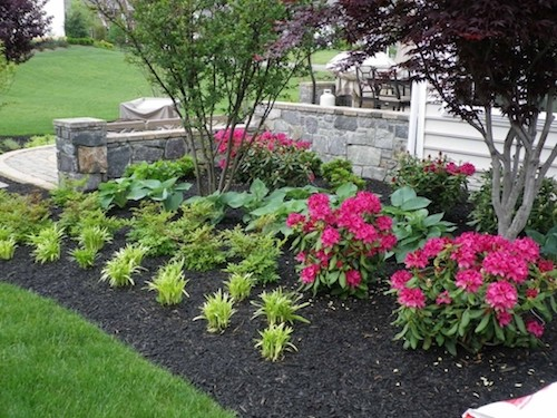 flower bed garden design next to stone walkway in northern virginia