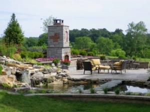 outdoor landscaping patio with fireplace and water feature northern virginia