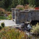 stone bridge water feature stone walkway great falls