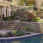 backyard stone swimming pool hardscape great falls virginia