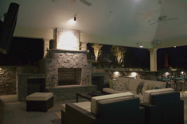 outdoor patio with fireplace and lighting great falls