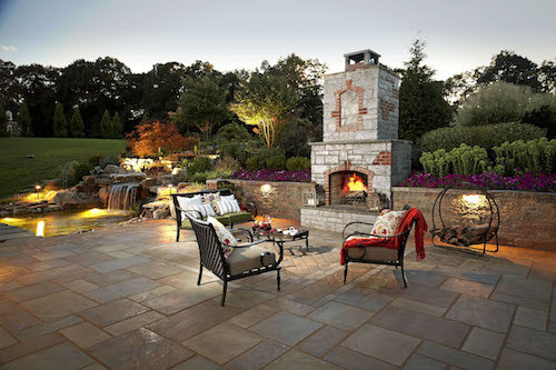 outdoor patio with landscape lighting and fireplace northern virginia, reston, leesburg