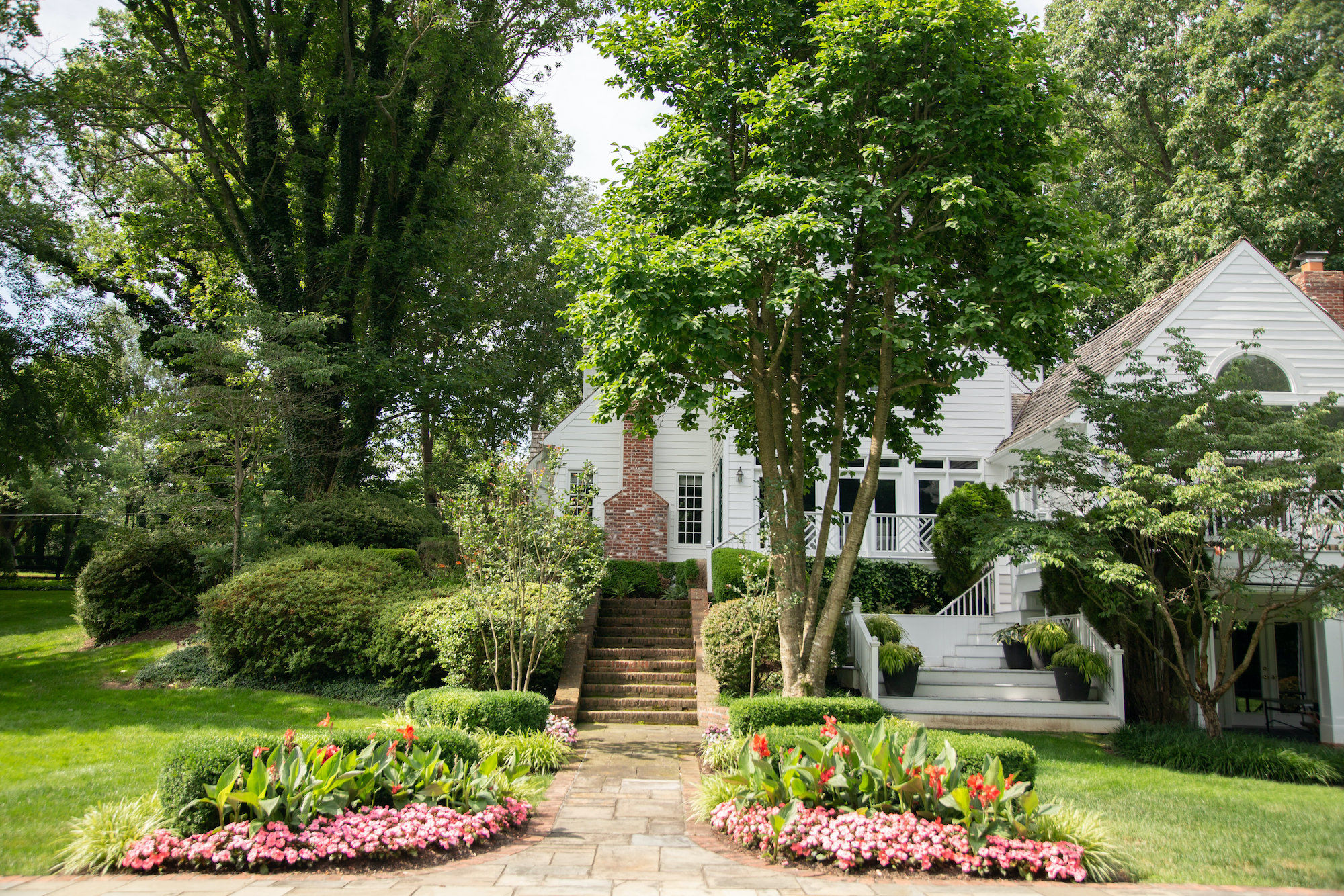 Spring landscaping with blooming flowers and green grass Reston Leesburg Northern Virginia